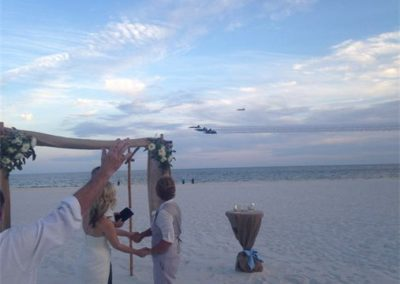Blue Angels flyover during a beach wedding ceremony