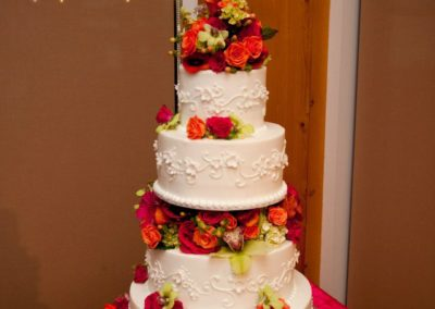 Wedding cake decorated with beautiful fresh flowers