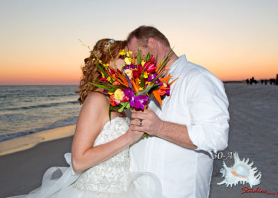 Bride and groom with a tropical wedding bouquet