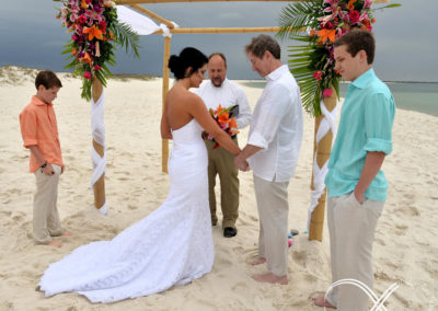 Fresh flowers on the arbor during the wedding ceremony