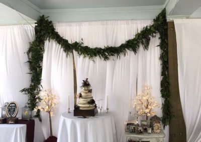 Fresh green garland decorating the cake