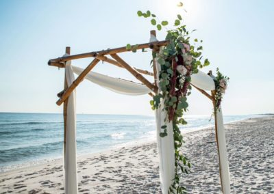Arbor with fresh floral arrangements