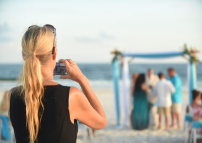 Making a video during the beach wedding ceremony