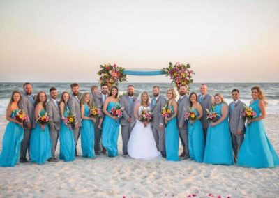 Bridal party with an arbor